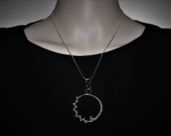 Silver circle pendant with silver beads