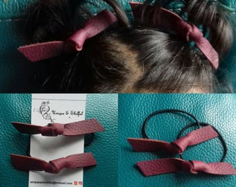 Assorted genuine leather knot baby hair bobbles. Pair.