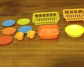 Vintage 1950s Barbie mini plastic dishes, fry pan, casserole, and dish racks