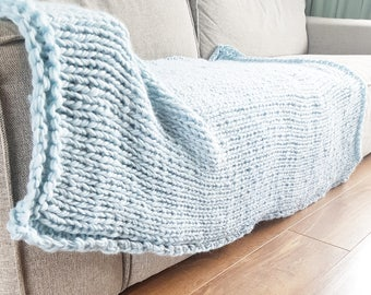 Knitted blanket light blue