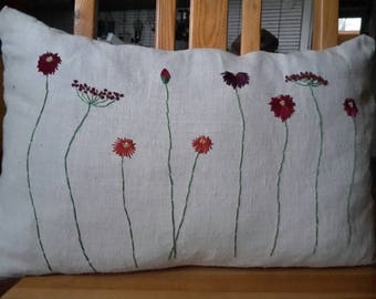 Hand embroidered linen pillow with flowers