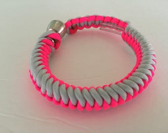 Grey and Neon Pink Paracord Bracelet with pipe