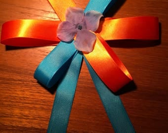 Orange and blue flowed hand crafted hair bow