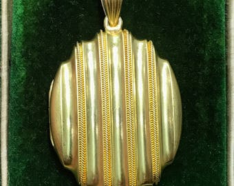 Antique Victorian Etruscan Revival gold locket from 1867