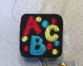 Teacher badge reel