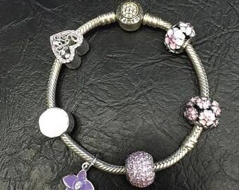 Silver 925 bandora bracelet with 7 charms