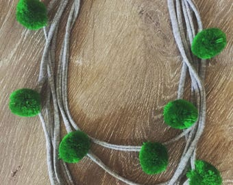 Grey jersey yarn necklace with green pom poms
