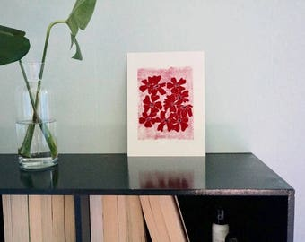 Summer flower floral print in red on pink background with dark blue linocut lino handmade