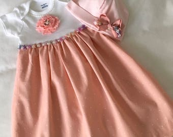 3-6 mo. Onesie dress..Salmon short sleeved  and matching hat.