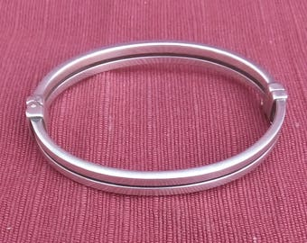 A stylish continental silver bangle