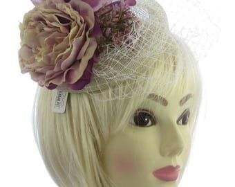 Ivory cream and Lilac with criss cross netting on a long clip,hatinator, weddings, races, ladies day