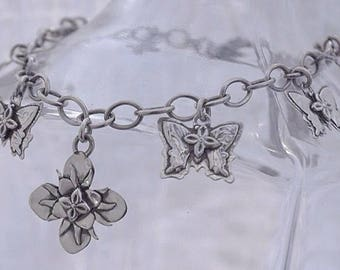 Ooak sterling silver butterfly and flower charm bracelet.