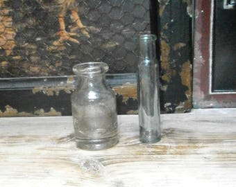 two antique glass bottles, vases/ clear glass/glassware/British