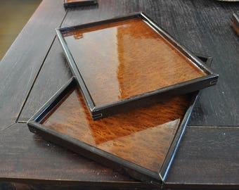2 medium sized serving trays made of african Wenge, Redwood burl top, Oukome bottom. Maple trim around corner inserts
