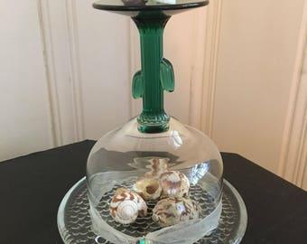 Upside down wine glass with sea shell display