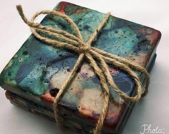 Tile coasters in beautiful earth tones, blue,green, rust and cream colors. Original art