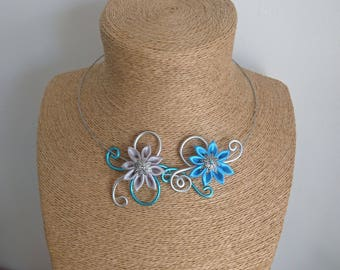Aluminum necklace with turquoise and gray kanzashi flowers.