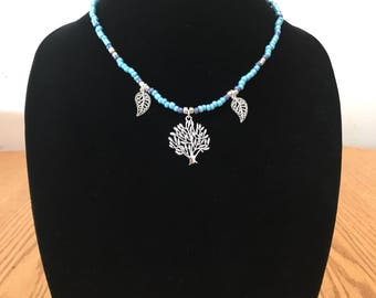Beaded tree necklace. Beautiful tree pendant with accent leaves. Perfect for fall.
