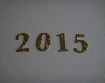 Cutting 2015 cardboard glitter gold for creation