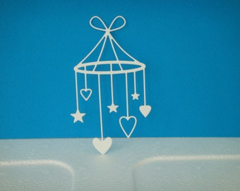 Cutting white hearts baby mobile and stars