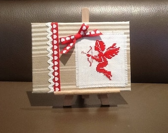 Angel Cupid red ticking on frame