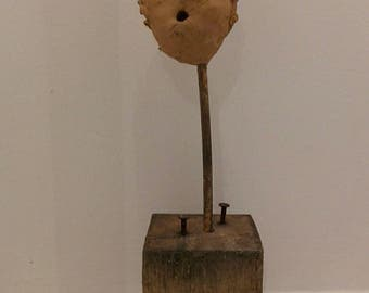 sculpture in clay on a square pedestal palette