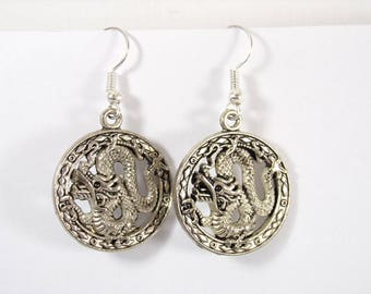 Silver charm in a circle dragon earrings