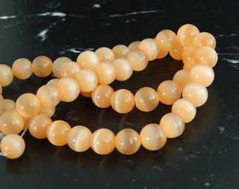 10 orange cat eye beads