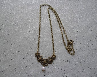 Mid-long necklace in metal bronze