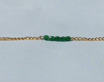Green beads and gold chain bracelet