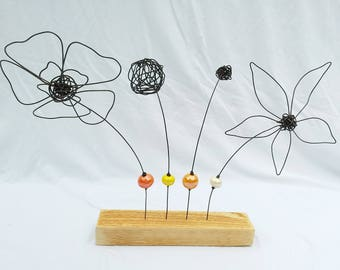 Flowers, leaves in wire and beads on wooden stand, Orange and yellow and ecru