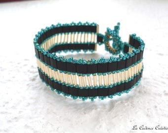 flat black, seed beads Golden tubes and iridescent green seed beads bracelet