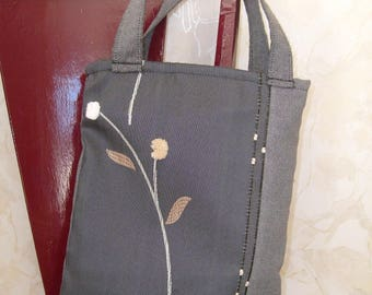 hand bag in gray fabric with pretty embossed pattern