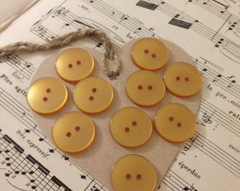 10 large iridescent orange buttons