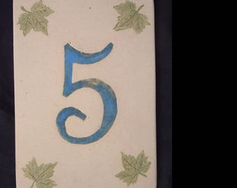 Door number '5' green leaves