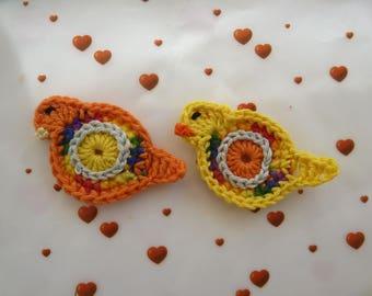 Two little ducks in yellow, orange, grey and multicolored cotton crochet