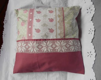 old pink Cushion cover and small flowers