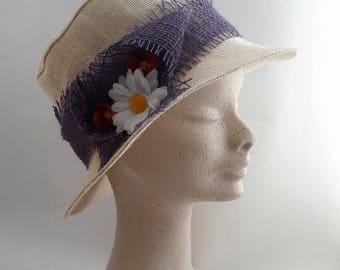 the hat is white oval purple headband