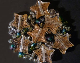 49 star shapes Crystal pink, gray, green Indian glass beads