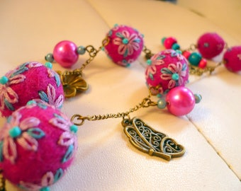 necklace made of wool felted and embroidered pink and blue beads