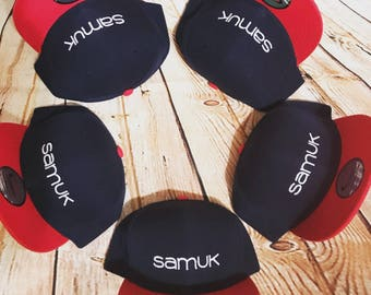 Snapback hats, red white and blue with SAMUK logo