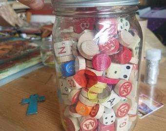 dice, bingo pieces, game pieces mason jar
