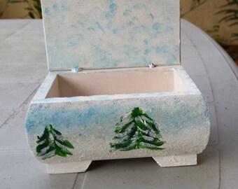 Box rectangular shutting snowy trees