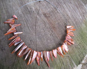 The Choker necklace of shark teeth shape orange Pearl