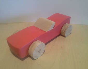 Wooden Toy: the pink car made of beech wood