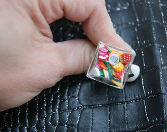 "square glass filled ""gluttony"" ring"
