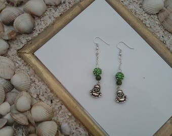 pair of earrings green anise and rhinestone beads and black