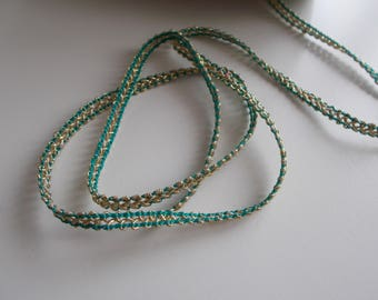 2.5 m of yarn braided in turquoise and gold tones