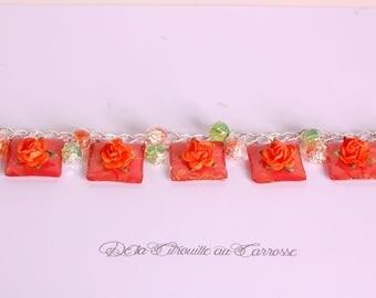 Orange flowers, Orange and green Beads Bracelet