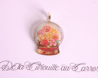 Ball pendant with snow, flowers
